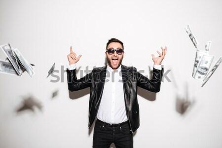 Retrato alegre barbudo homem falante telefone móvel Foto stock © deandrobot