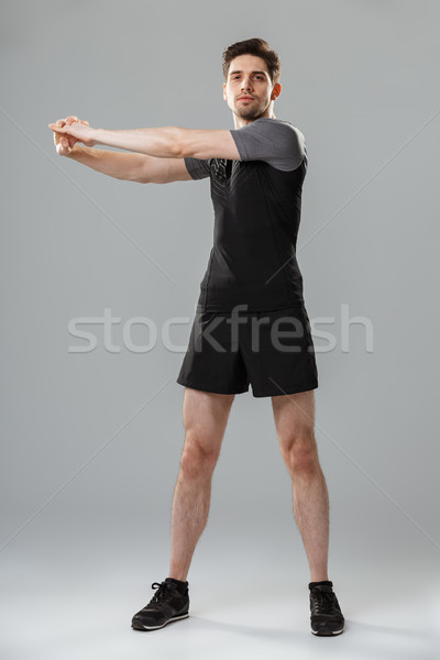 Full length portrait of a motivated young sportsman Stock photo © deandrobot