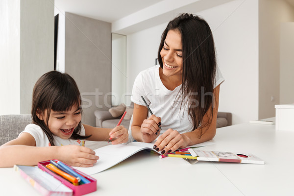 Portrait of young family mother and child spending time together Stock photo © deandrobot