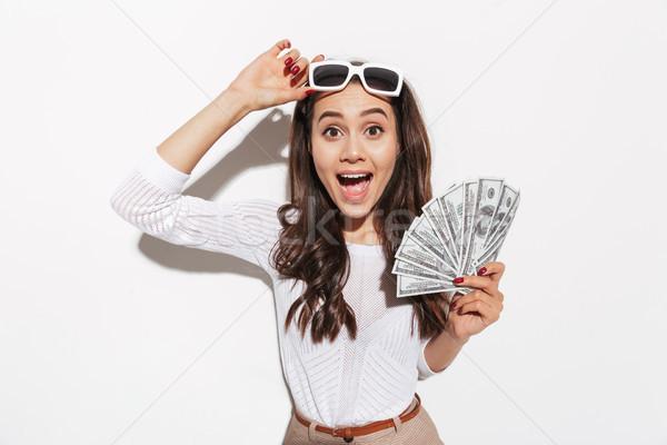 Geschokt asian vrouw geld foto Stockfoto © deandrobot