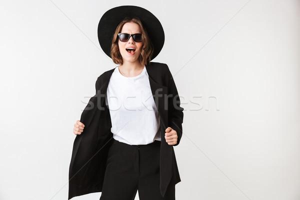 Portret wesoły młoda kobieta czarny kurtka okulary Zdjęcia stock © deandrobot