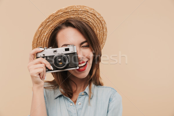 Portrait of a happy young girl taking a picture Stock photo © deandrobot
