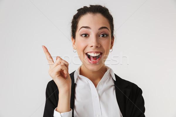 Podniecony szczęśliwy młodych business woman wskazując obraz Zdjęcia stock © deandrobot