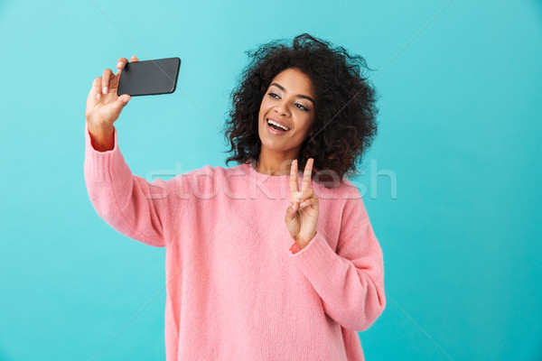 Portrait of gorgeous young woman making selfie on her smartphone Stock photo © deandrobot