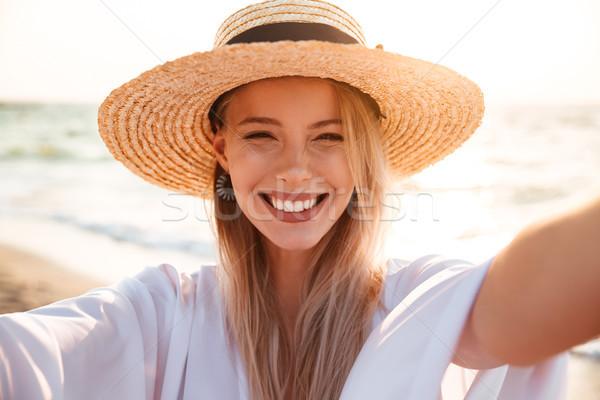 портрет кавказский красивая женщина 20-х годов лет соломенной шляпе Сток-фото © deandrobot