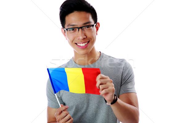 Mutlu genç Asya adam bayrak Stok fotoğraf © deandrobot