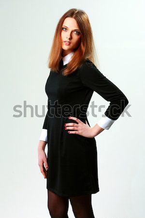 Jóvenes mujer vestido ocasional gris cara Foto stock © deandrobot