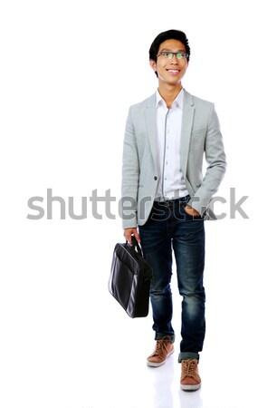 Gelukkig asian man lopen aktetas witte Stockfoto © deandrobot