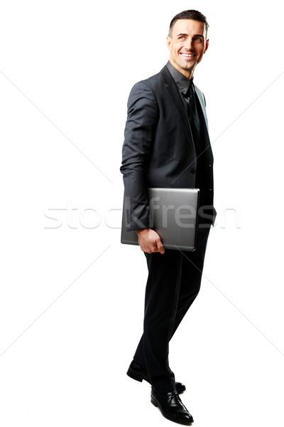 портрет бизнесмен Постоянный ноутбука изолированный белый Сток-фото © deandrobot