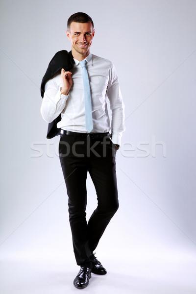 Teljes alakos portré boldog üzletember tart kabát Stock fotó © deandrobot