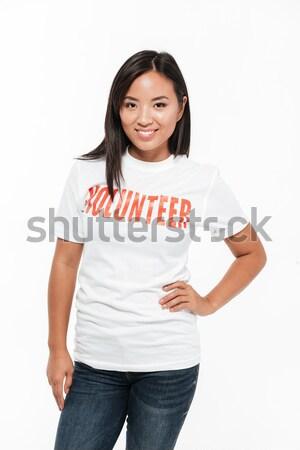 Trendi mosolygó nő pózol izolált fehér néz Stock fotó © deandrobot