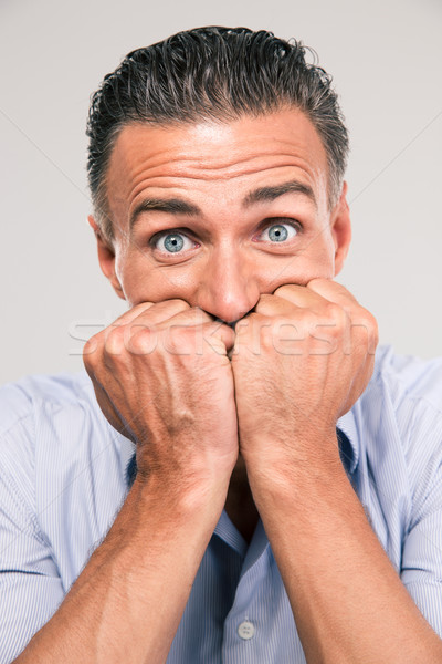 Portrait of a frightened man looking at camera Stock photo © deandrobot