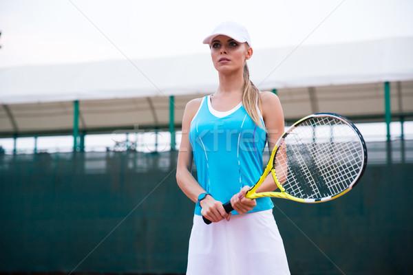 Portrait of a charming female tennis player Stock photo © deandrobot