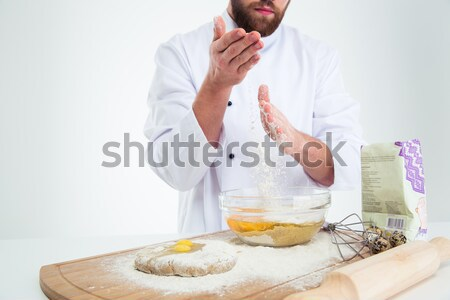 Man breaking eggs into a bowl for baking  Stock photo © deandrobot