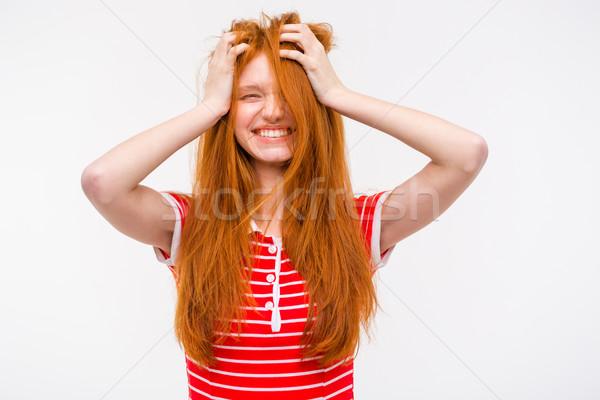 Grappig meisje rommelig haren holding handen hoofd Stockfoto © deandrobot