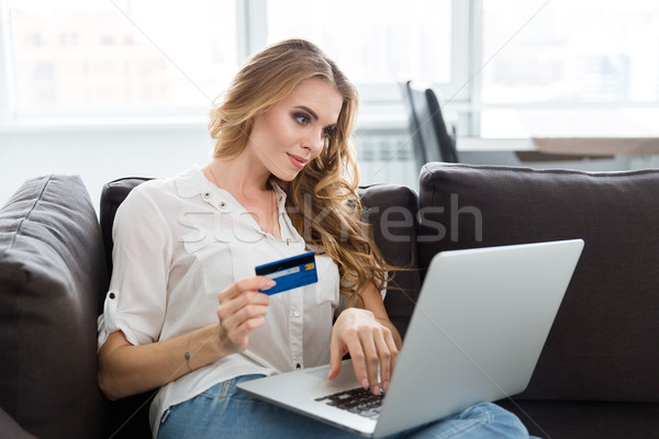 Happy woman making purchases in internet using credit card  Stock photo © deandrobot