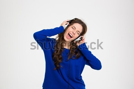 Stressed frustrated woman covered ears by hands and screaming Stock photo © deandrobot