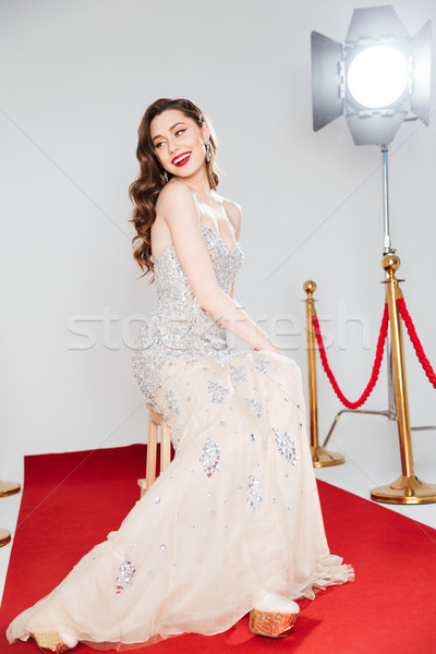 Attractive woman on red carpet Stock photo © deandrobot
