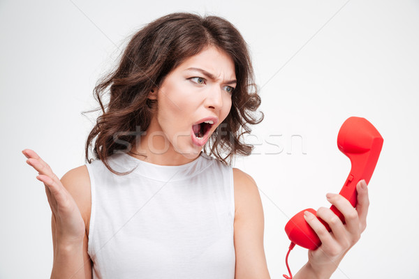 Angry woman screaming on phone tube Stock photo © deandrobot