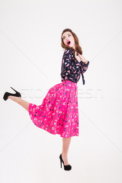 Surprised playful pretty young woman with opened mouth  Stock photo © deandrobot
