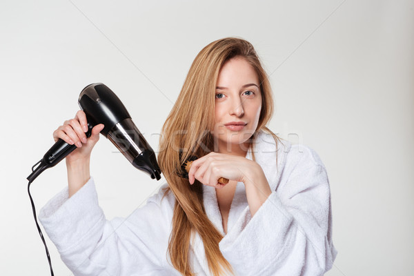 Attractive woman drying her hair Stock photo © deandrobot