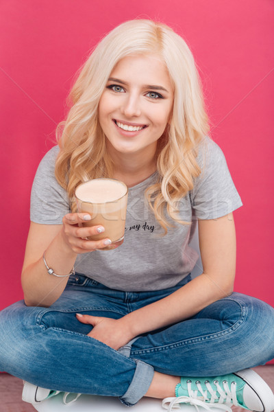 Smiling woman holding glass with cappuccino Stock photo © deandrobot