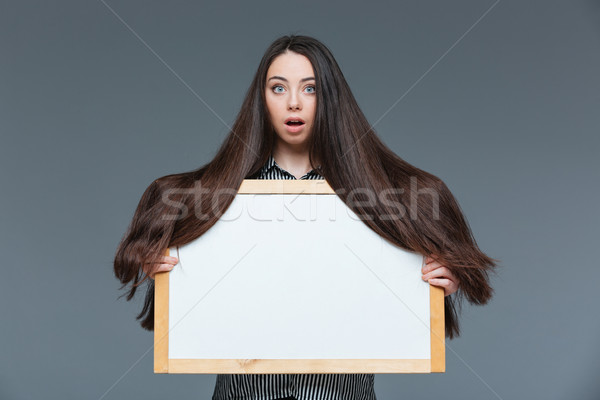 Woman with long hair holding blank board Stock photo © deandrobot