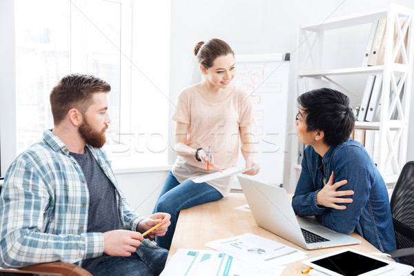 Businesspeople working and making new project in office together Stock photo © deandrobot