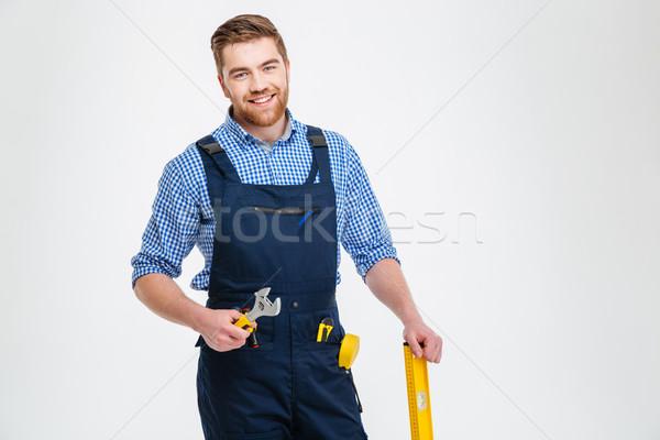 Portrait of a happy male builder Stock photo © deandrobot