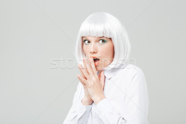 Curious amazed young woman with opened mouth Stock photo © deandrobot