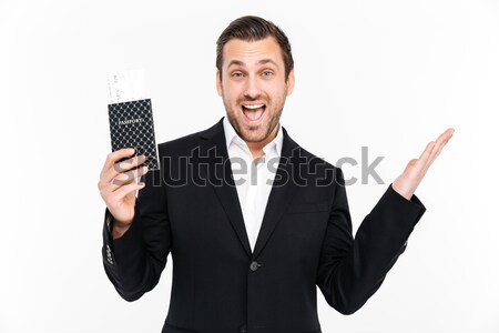 Crazy cheerful young man put gun to temple and laughing Stock photo © deandrobot