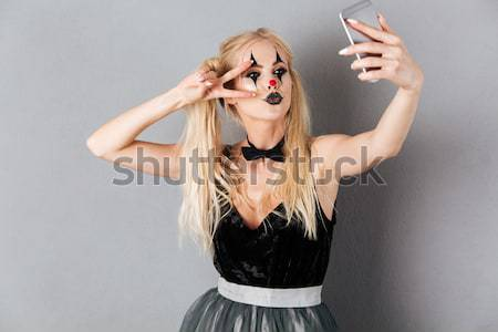 Criminal man put gun to temple of beautiful woman Stock photo © deandrobot