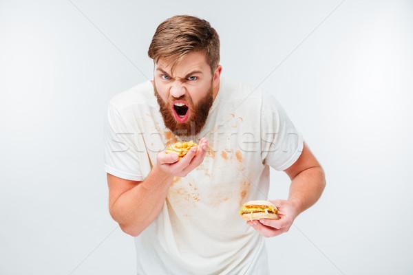 Excité faim barbu homme manger Photo stock © deandrobot