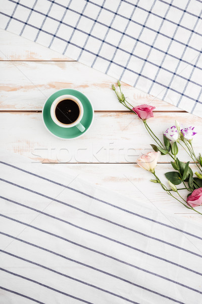 Flowers, cup of coffee between striped and plaid napkins Stock photo © deandrobot