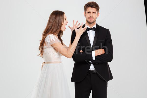 Portrait of young couple conflict Stock photo © deandrobot