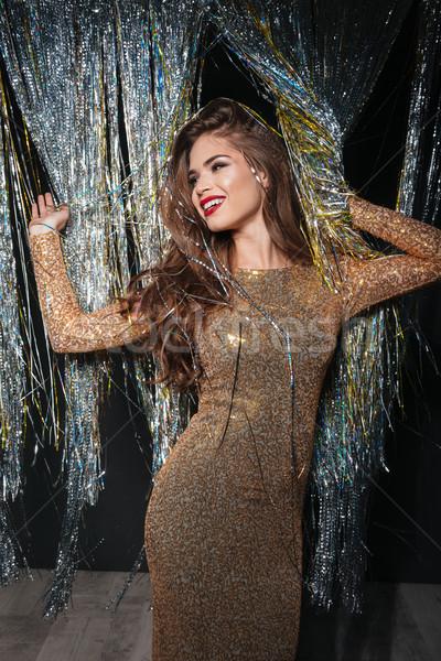 Boldog fiatal nő estélyi ruha áll pózol ragyogó Stock fotó © deandrobot