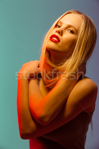 Káprázatos fiatal nő piros ajkak áll ölel szőke nő Stock fotó © deandrobot