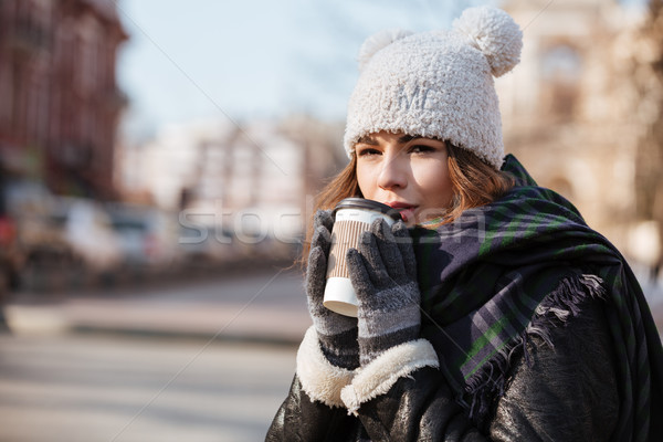 Woman drinking coffee to go outdoors in cold weather Stock photo © deandrobot