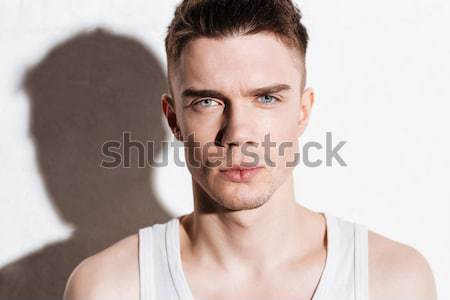 Portrait of serious handsome young man with blue eyes Stock photo © deandrobot