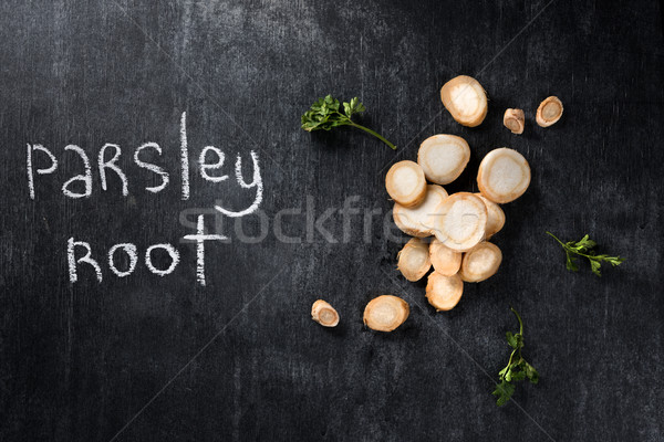 Perejil raíz oscuro pizarra superior vista Foto stock © deandrobot