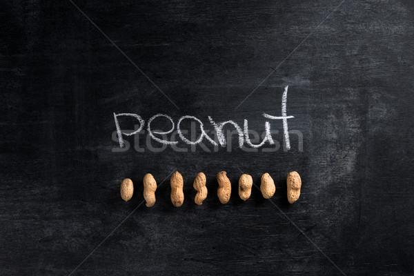 Stock photo: Peanut over dark chalkboard background