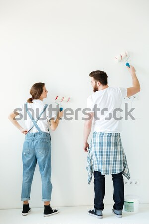 Back view of couple making repair Stock photo © deandrobot