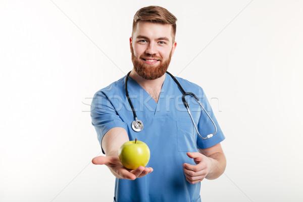 Portre yakışıklı doktor mavi kat bakıyor Stok fotoğraf © deandrobot