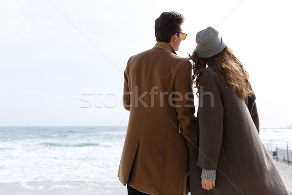 Back view of couple enjoying the view on the beach Stock photo © deandrobot