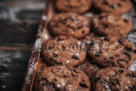 Cookies on desk on dark wooden table Stock photo © deandrobot