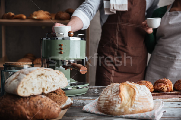 Loving couple bakers drinking coffee. Stock photo © deandrobot