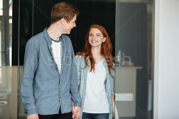 Pretty couple looking at each other Stock photo © deandrobot