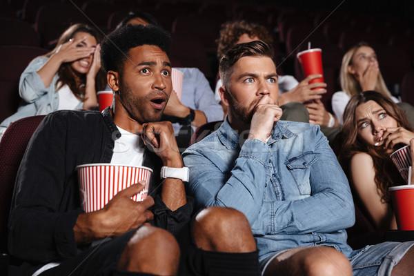страшно молодые друзей сидят кино Смотреть Сток-фото © deandrobot