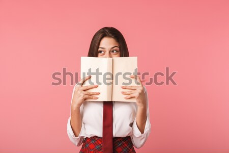 Happy young blonde woman covering face with tablet computer. Stock photo © deandrobot