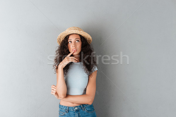 Beautiful woman looking at camera seriously isolated Stock photo © deandrobot